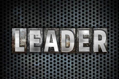 metal grid: The word Leader written in vintage metal letterpress type on a black industrial grid background.