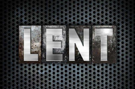 atonement: The word Lent written in vintage metal letterpress type on a black industrial grid background. Stock Photo