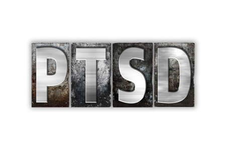 traumatic: The word PTSD written in vintage metal letterpress type isolated on a white background.