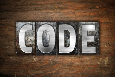 secret code: The word Code written in vintage metal letterpress type on an aged wooden background. Stock Photo