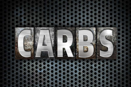 carbs: The word Carbs written in vintage metal letterpress type on a black industrial grid background.