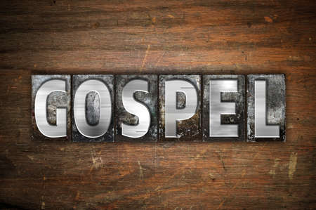 parable: The word Gospel written in vintage metal letterpress type on an aged wooden background. Stock Photo