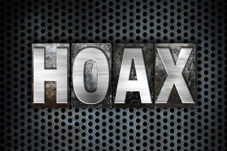 The word Hoax written in vintage metal letterpress type on a black industrial grid background. Stock Photo