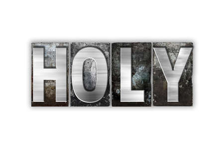 sanctified: The word Holy written in vintage metal letterpress type isolated on a white background. Stock Photo