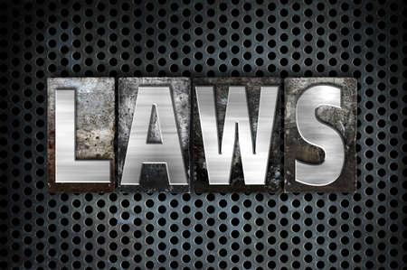"""edicto: La expresión """"leyes"""" escrito en tipo de cosecha tipografía de metal sobre un fondo negro Red industrial."""