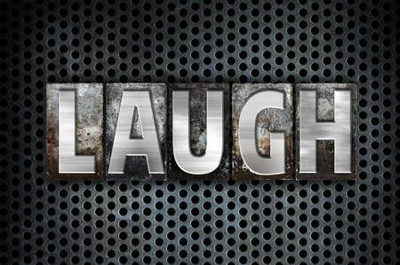 metal grid: The word Laugh written in vintage metal letterpress type on a black industrial grid background.