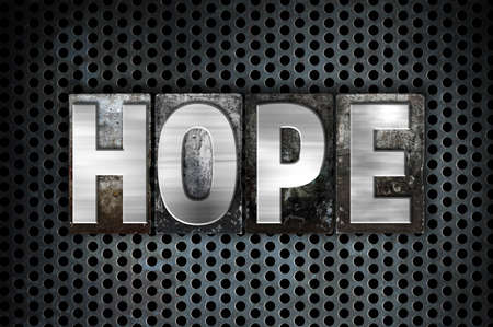 The word Hope written in vintage metal letterpress type on a black industrial grid background. Stock Photo