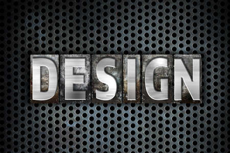 The word Design written in vintage metal letterpress type on a black industrial grid background. Stock Photo