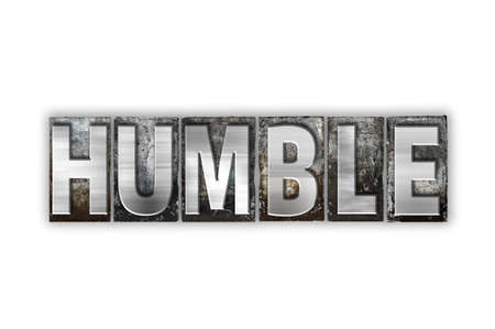 humbled: The word Humble written in vintage metal letterpress type isolated on a white background. Stock Photo