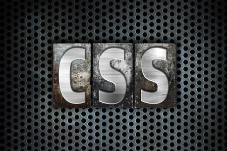 css: The word CSS written in vintage metal letterpress type on a black industrial grid background. Stock Photo