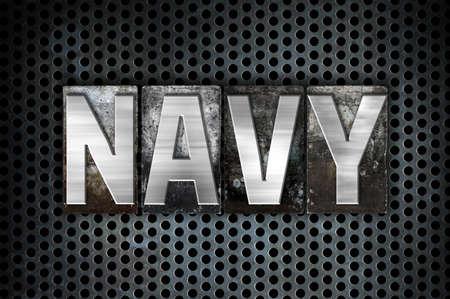 metal grid: The word Navy written in vintage metal letterpress type on a black industrial grid background. Stock Photo