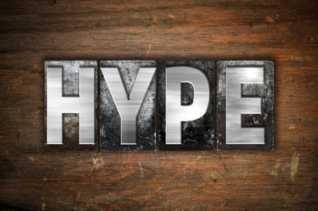 hype: The word Hype written in vintage metal letterpress type on an aged wooden background. Stock Photo