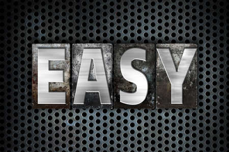 metal grid: The word Easy written in vintage metal letterpress type on a black industrial grid background.