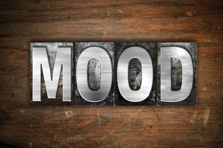mood moody: The word Mood written in vintage metal letterpress type on an aged wooden background. Stock Photo