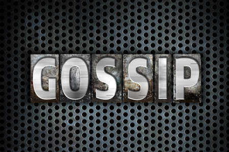hearsay: The word Gossip written in vintage metal letterpress type on a black industrial grid background. Stock Photo