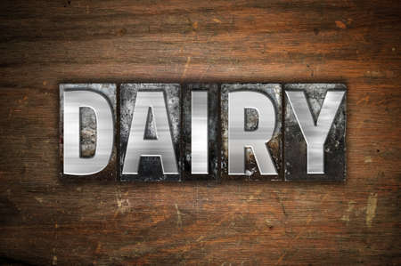 lactose intolerant: The word Dairy written in vintage metal letterpress type on an aged wooden background. Stock Photo