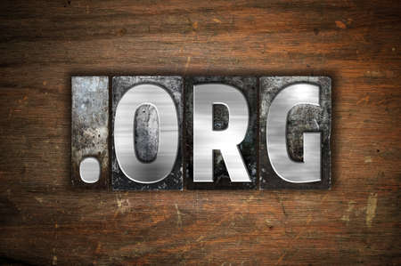 org: The word Dot org written in vintage metal letterpress type on an aged wooden background. Stock Photo