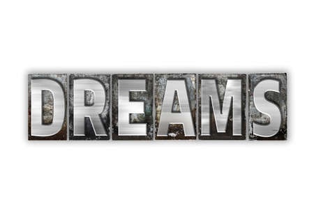 The word Dreams written in vintage metal letterpress type isolated on a white background.