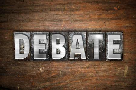rebuttal: The word Debate written in vintage metal letterpress type on an aged wooden background. Stock Photo