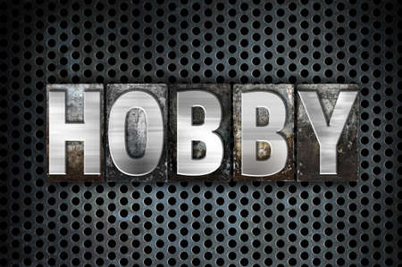 The word Hobby written in vintage metal letterpress type on a black industrial grid background.