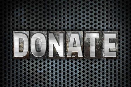 """La parola """"Donate"""" scritta in metallo tipo vintage tipografica su uno nero industriale griglia di sfondo. Archivio Fotografico - 51396182"""