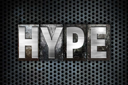 hype: The word Hype written in vintage metal letterpress type on a black industrial grid background. Stock Photo