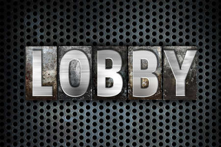 foyer: The word Lobby written in vintage metal letterpress type on a black industrial grid background. Stock Photo