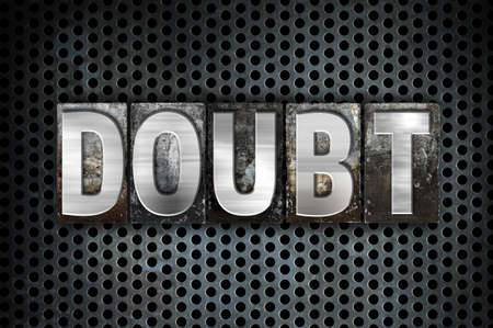 The word Doubt written in vintage metal letterpress type on a black industrial grid background.