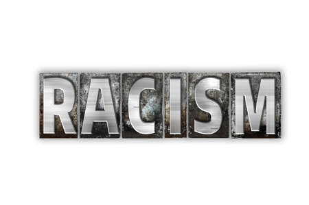 bigotry: The word Racism written in vintage metal letterpress type isolated on a white background.