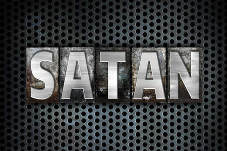 antichrist: The word Satan written in vintage metal letterpress type on a black industrial grid background. Stock Photo
