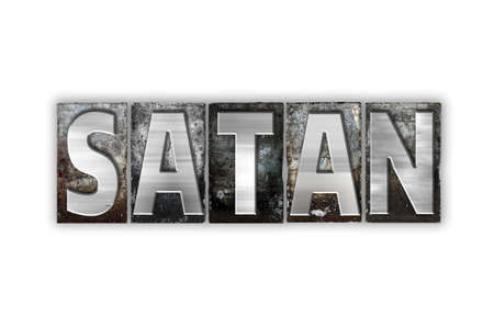 antichrist: The word Satan written in vintage metal letterpress type isolated on a white background.