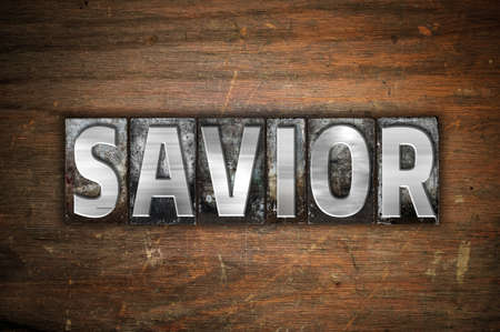 the liberator: The word Savior written in vintage metal letterpress type on an aged wooden background. Stock Photo