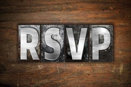 rsvp: The word RSVP written in vintage metal letterpress type on an aged wooden background.