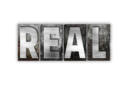 realism: The word Real written in vintage metal letterpress type isolated on a white background. Stock Photo