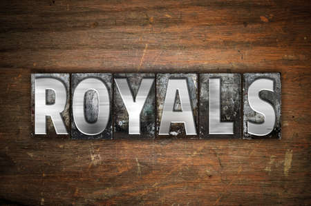 royals: The word Royals written in vintage metal letterpress type on an aged wooden background. Stock Photo