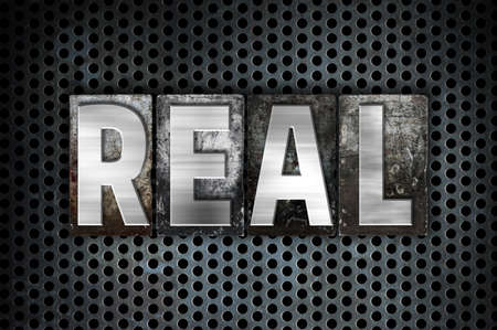 legitimate: The word Real written in vintage metal letterpress type on a black industrial grid background. Stock Photo