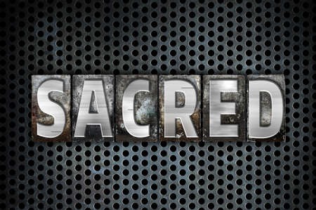 hallowed: The word Sacred written in vintage metal letterpress type on a black industrial grid background. Stock Photo