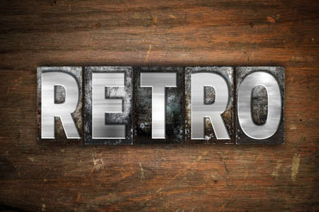 yesteryear: The word Retro written in vintage metal letterpress type on an aged wooden background.