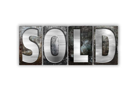 sold isolated: The word Sold written in vintage metal letterpress type isolated on a white background.