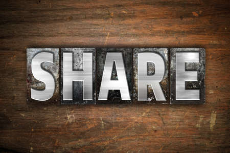 shared sharing: The word Share written in vintage metal letterpress type on an aged wooden background. Stock Photo