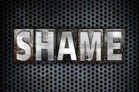 disgrace: The word Shame written in vintage metal letterpress type on a black industrial grid background. Stock Photo