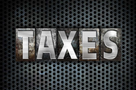 levy: The word Taxes written in vintage metal letterpress type on a black industrial grid background.