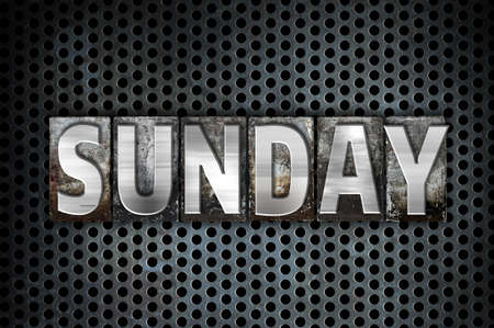 The word Sunday written in vintage metal letterpress type on a black industrial grid background. Stock Photo