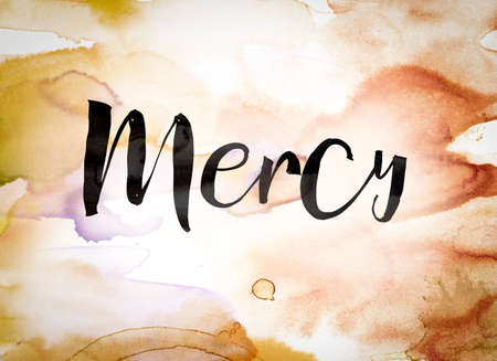 compassionate: The word Mercy written in black paint on a colorful watercolor washed background.