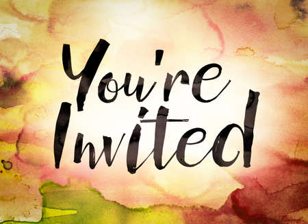The word Youre Invited written in black paint on a colorful watercolor washed background.