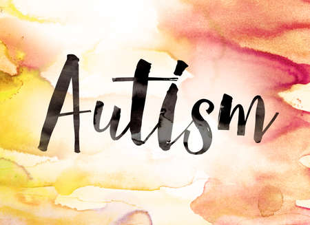 asperger syndrome: The word Autism written in black paint on a colorful watercolor washed background.