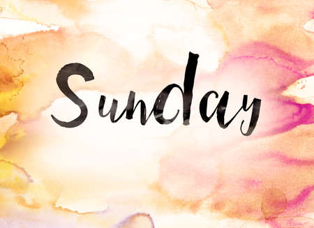 sunday paper: The word Sunday written in black paint on a colorful watercolor washed background.