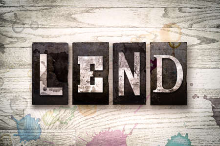 lend: The word LEND written in vintage dirty metal letterpress type on a whitewashed wooden background with ink and paint stains.
