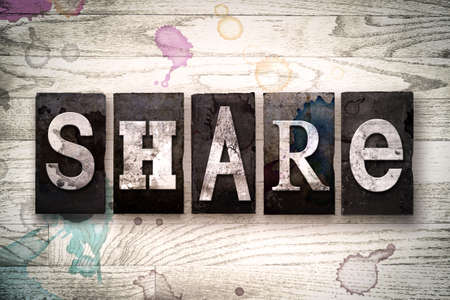 shared sharing: The word SHARE written in vintage dirty metal letterpress type on a whitewashed wooden background with ink and paint stains. Stock Photo