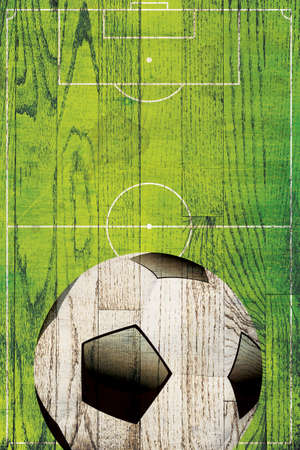 A soccer ball and field painted over a hard wood plank background.